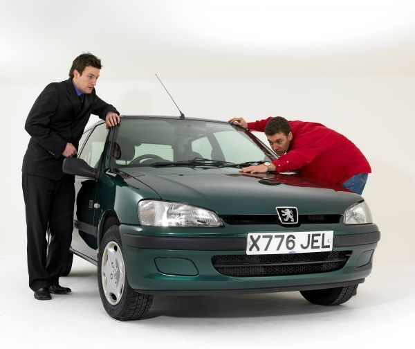 Car salesman helping a buyer make his choice