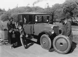 1925 Cleveland 6 having wheel changed after puncture