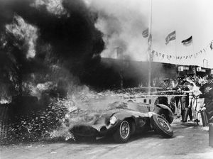 Aston Martin DBR1 on fire in pits during 1959 TT at Goodwood, Moss-Salvadori drivers.