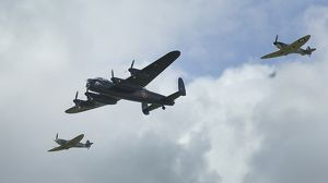 lancaster bomber with 2 spitfire fighter planes
